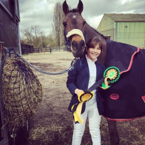 Libby with Arnie holding rosettes