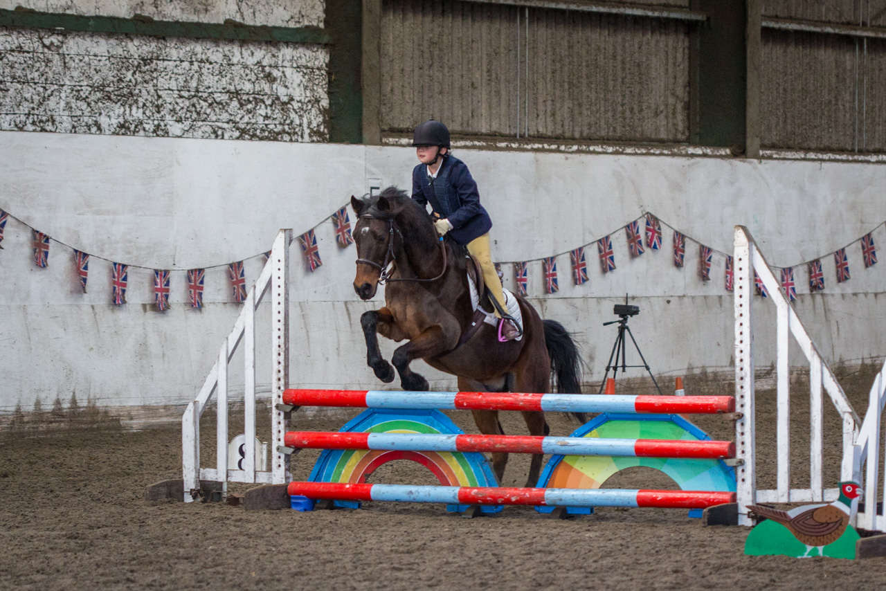 Libby competing in showjumping at Newton Hall