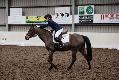 Libby congratulates Arnie after a dressage competition